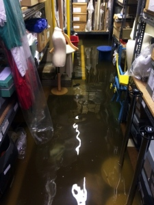 The flood in the store at it's worst Friday morning before the Fire Brigade came. The photo shows the pervasive power of water, it gets into everything.