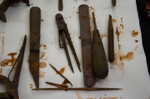 Water damaged tools drying on blotting paper, waiting to be cleaned and repackaged.